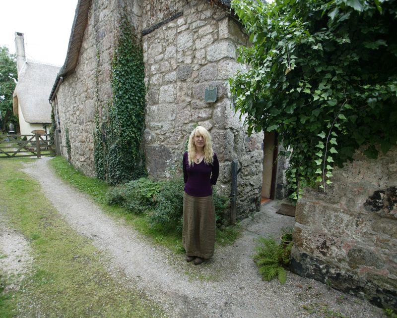 Terri Windling outside Weaver's Cottage (photograph by Alan Lee)